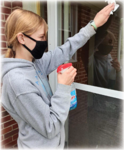 Girl cleaning a window